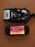 PSP 3004 slim + 4 jocuri + husa + card memorie