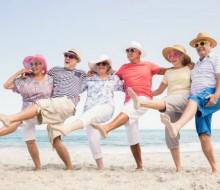 Elderly-People-Dacing-on-a-Beach-600x400