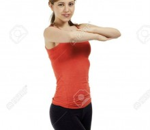 14748298-young-fitness-woman-exercising-with-folded-arms-on-white-background
